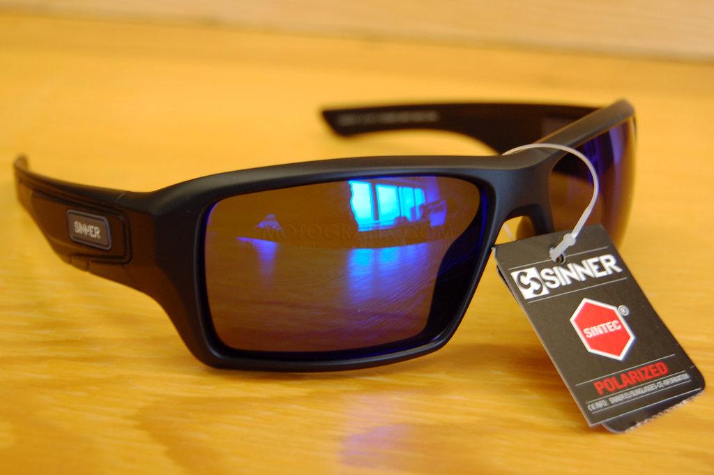 24d86aad2227 Sinner eyewear sunglasses sunburst matte black frame with blue revo  polarised Sintec lens
